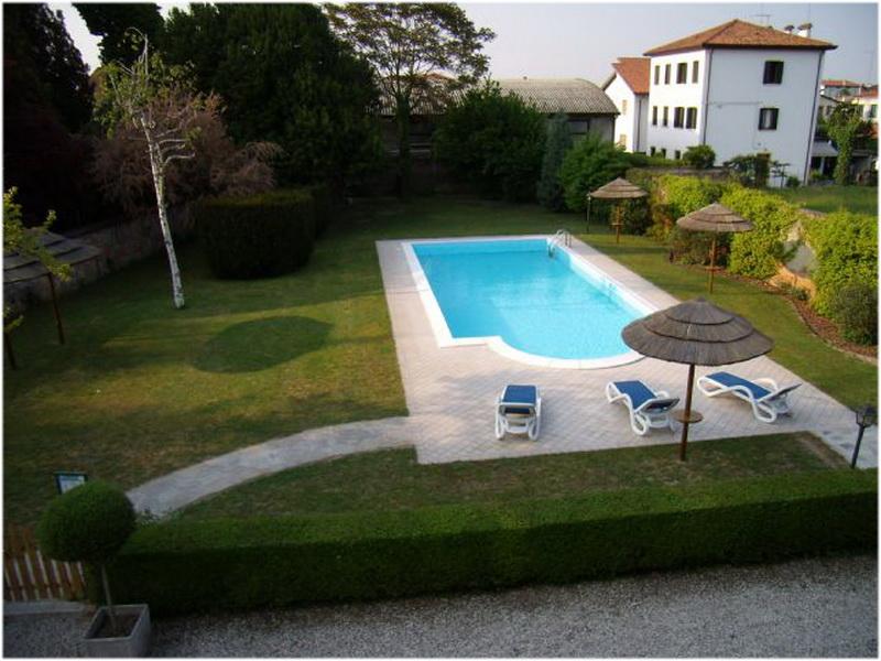Hotel isola di caprera venise italie cap voyage for Hotel venise piscine interieure